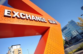 Orange arrow with Exchange Quay white text