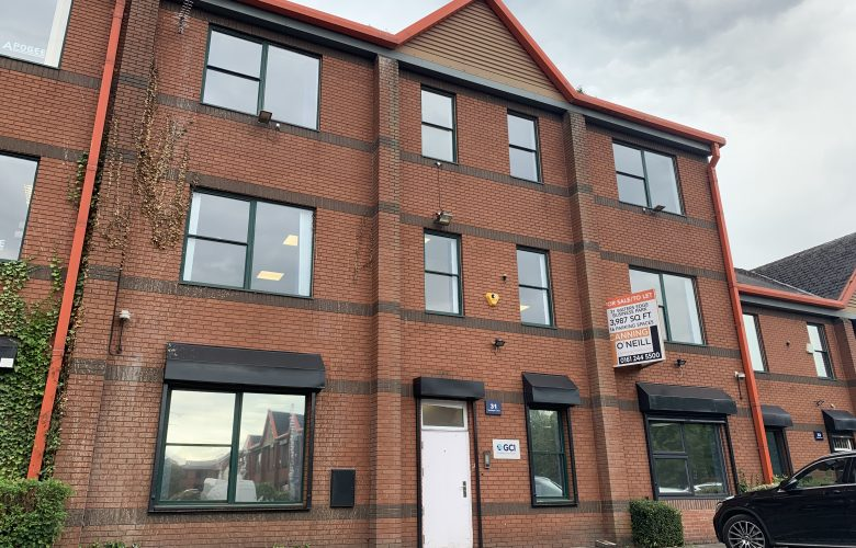 red brick office property with white door
